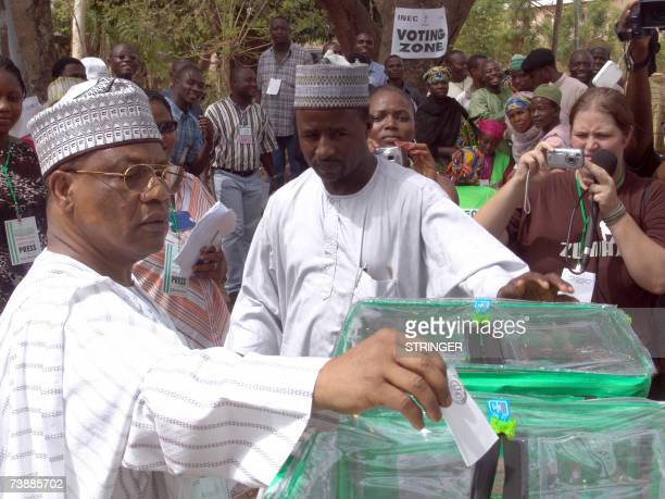 Nigeria's former Military President General Ibrahim Babangida casts his vote 14 April 2007 at the 020 polling station in the Uphill Water Tank for...
