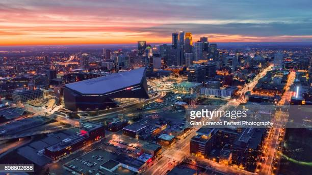 minneapolis and us bank stadium skyline at dusk - minneapolis stock photos and pictures