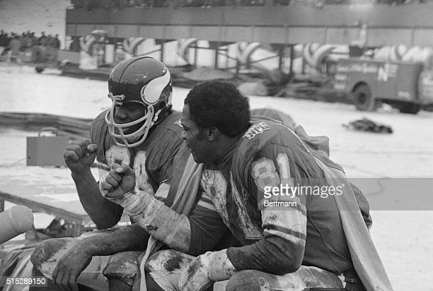 Carl Eller and Alan Page clench fists on the Vikings bench shortly after Page intercepted a LA Rams pass in the closing minutes of ball game Vikings...