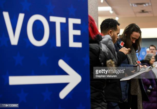 Minneapolis City Council member Jeremiah Ellison and other voters fill out registration forms on the first day of early voting for the US...