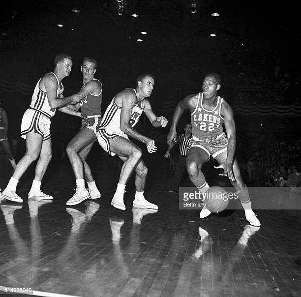 Minneapolis Lakers' Elgin Baylor moves in for another tally in 1st quarter action here 11/10 night against St Louis Hawks Baylor recently set NBA...