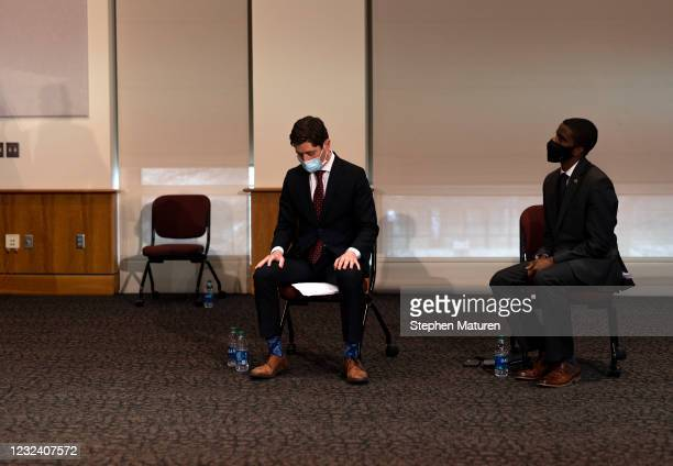 Minneapolis Mayor Jacob Frey and St. Paul Mayor Melvin Carter listen as Minnesota Governor Tim Walz speaks during a press conference about public...