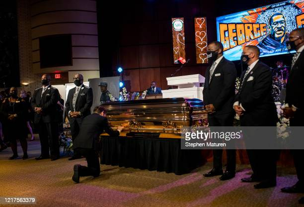 Minneapolis Mayor Jacob Frey kneels at the casket of George Floyd before a memorial service at North Central University on June 4 2020 in Minneapolis...