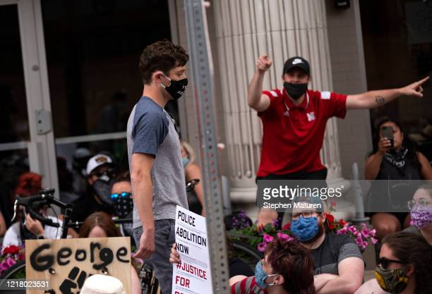 Minneapolis Mayor Jacob Frey leaves a demonstration calling for the Minneapolis Police Department to be defunded on June 6 2020 in Minneapolis...