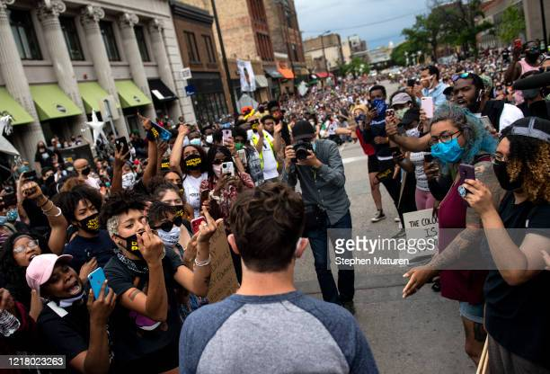 Minneapolis Mayor Jacob Frey leaves after coming out of his home to speak during a demonstration calling for the Minneapolis Police Department to be...