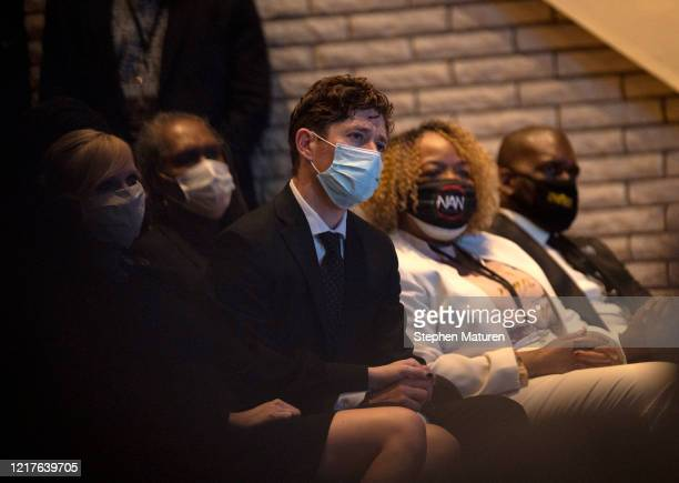 Minneapolis Mayor Jacob Frey listens as Rev Al Sharpton performs a eulogy during a memorial service for George Floyd at North Central University on...