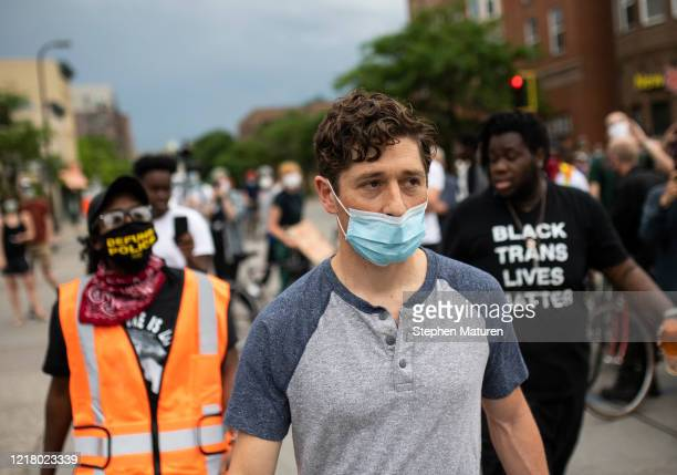 Minneapolis Mayor Jacob Frey looks over a demonstration calling for the Minneapolis Police Department to be defunded on June 6 2020 in Minneapolis...
