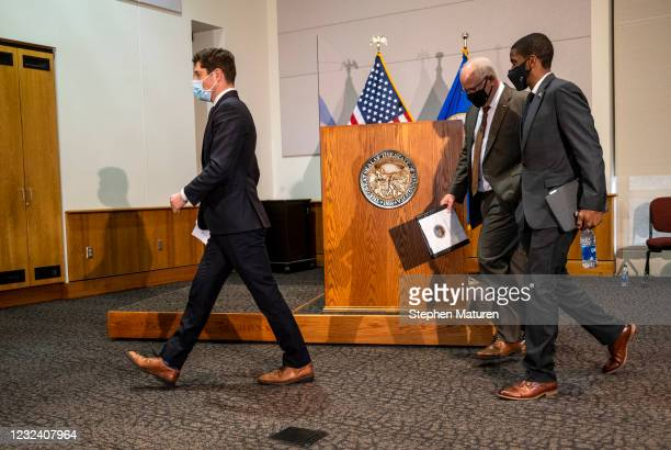 Minneapolis Mayor Jacob Frey, Minnesota Governor Tim Walz, and St. Paul Mayor Melvin Carter walk out together after speaking at a press conference...