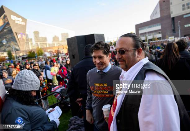 Minneapolis Mayor Jacob Frey poses for a photo at a protest rally outside US Bank Stadium before the game between the Washington Redskins and...