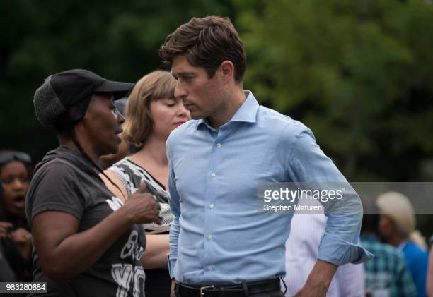 Minneapolis Mayor Jacob Frey speaks with a woman at a vigil for Thurman Blevins on June 24 2018 in Minneapolis Minnesota Blevins was shot and killed...
