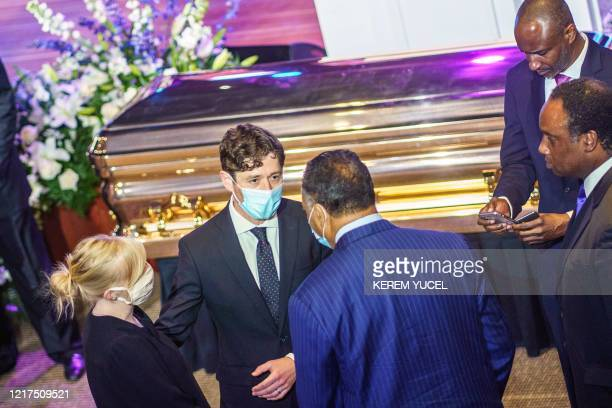 Minneapolis Mayor Jacob Frey speaks with Civil rights activist Reverend Reverend Jesse Jackson near the remains of George Floyd awaiting a memorial...