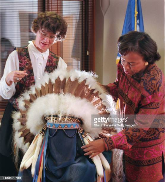 Minneapolis Mayor Sharon Sayles Belton looks at a replica of a Plains Indian headdress with Katie Fournier, the Minneapolis International...