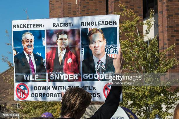 Minneapolis, Minnesota, Rally against racism, Protesting the Washington Redskins football teams nickname, Protester holding a sign with the owners of...