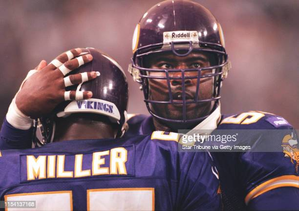 Minneapolis MN 10/3/99 Vikings vs Tampa Bay Buccaneers Viking defensive end Chris Doleman right congratulates teammate Corey Miller after Miller...