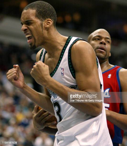 Minneapolis MN 1/15/02 Timberwolves LA ClippersTimberwolves Loren Woods reacts after he is fouled in the 4th peroid in the the background of the...