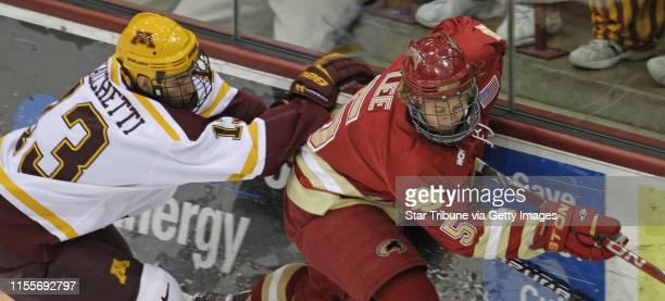 Minneapolis MN Friday ] University of Minnesota Gophers Hockey vs Denver Minnesota's Nico Sacchetti and Denver's John Lee battled for the puck in...