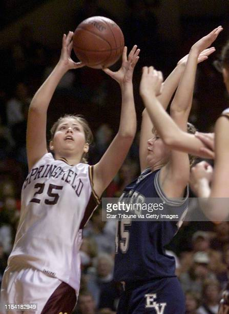 Minneapolis MN Friday 3/16/2001 Class 1A girls basketball semifinals Eden ValleyWatkins vs Springfield Springfield's Jacqueline Schultz drove to the...