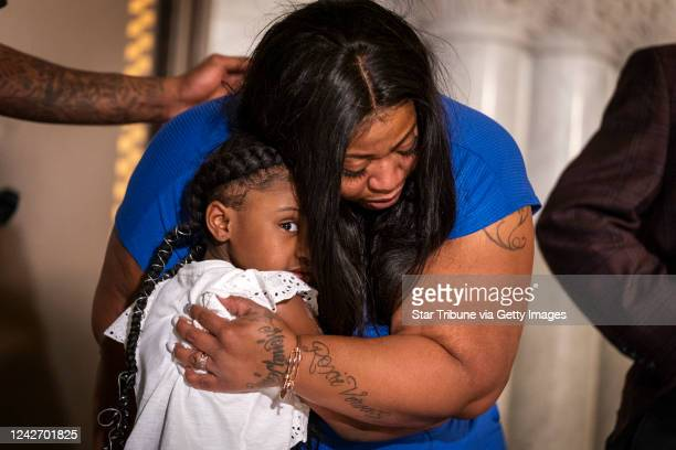 George Floyd's daughter Gianna Floyd gives her mother Roxie Washington a hug during a press conference at Minneapolis City Hall Roxie Washington the...