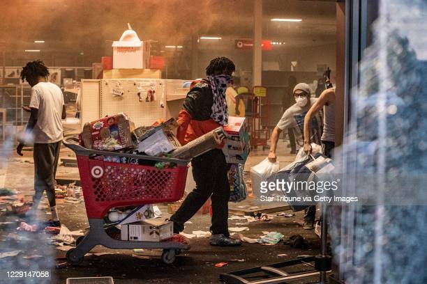 Looters entered the Target store on Lake Street and made out with merchandise on the second day of protest in the death of George Floyd