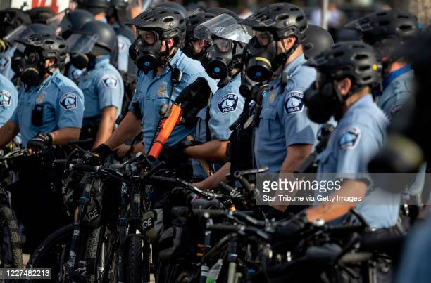 Minneapolis Police officers lined up as demonstrators protested the killing of George Floyd outside the Minneapolis Police Department's Third...