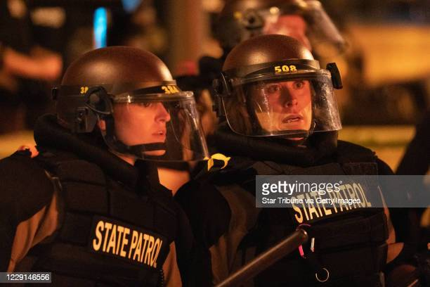 Minnesota State Patrol officers stood watch outside of the Third Precinct Protester and police clashed violently in South Minneapolis as looters...