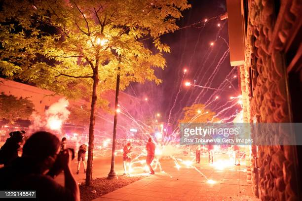 Protesters lobbed fireworks rocks and glass bottles at police near the Third PrecinctnProtester and police clashed violently in South Minneapolis as...