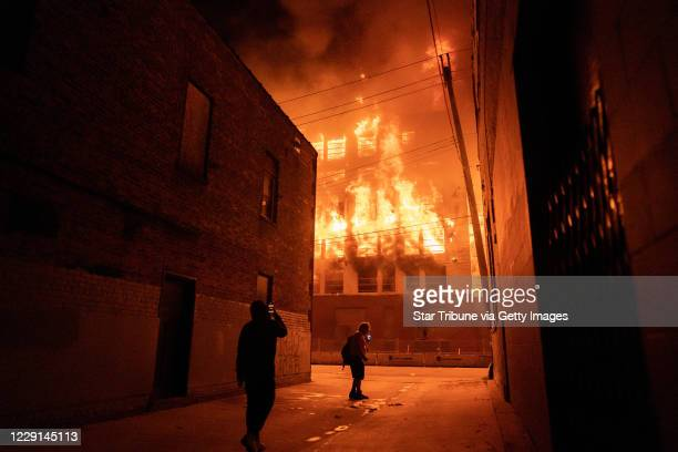 Rioters set fire to a multistory affordable housing complex under construction near the Third Precinct spreading the blaze to surrounding homes...