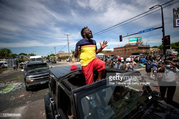 Former Minnesota Gopher and NFL player Tyrone Carter pleaded with protesters not to tear up their city at the site where George Floyd was killed at...