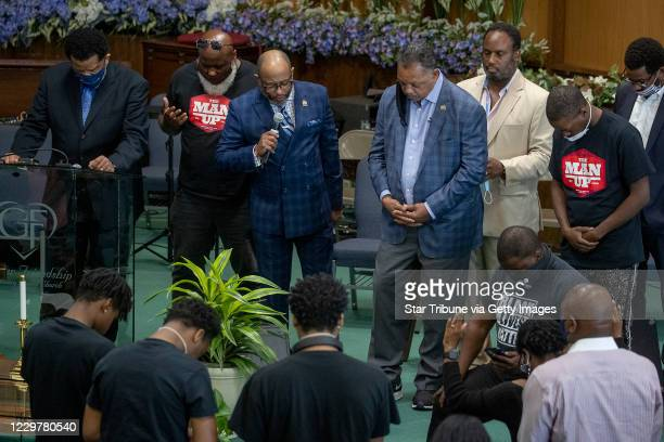 The Rev Jesse L Jackson center was surrounded by faith leaders as they stood in prayer after he spoke to send a message of solidarity and demand...