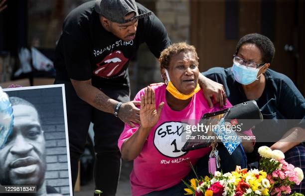 Tony L Clark left consoles Gwen Dumas where George Floyd was killed in front of the Cup Food Store Protesters gathered at 38th and Chicago where...