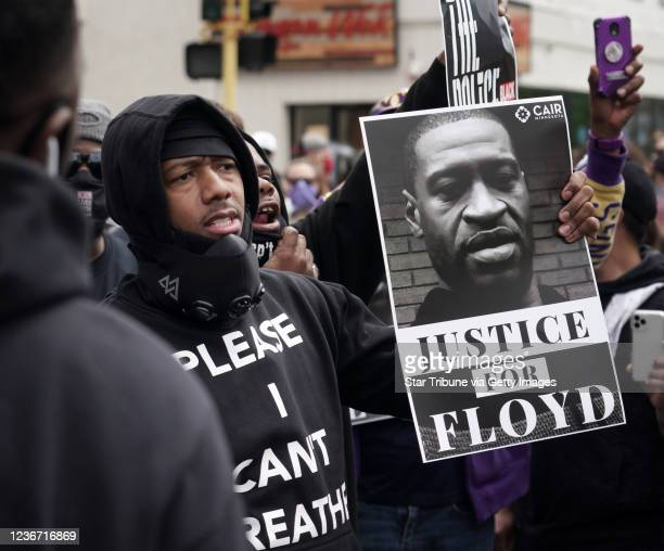 Peaceful protesters including Actor and comedian Nick Cannon celebrated the memory of George Floyd and demanded justice outside the Cup Foods store...