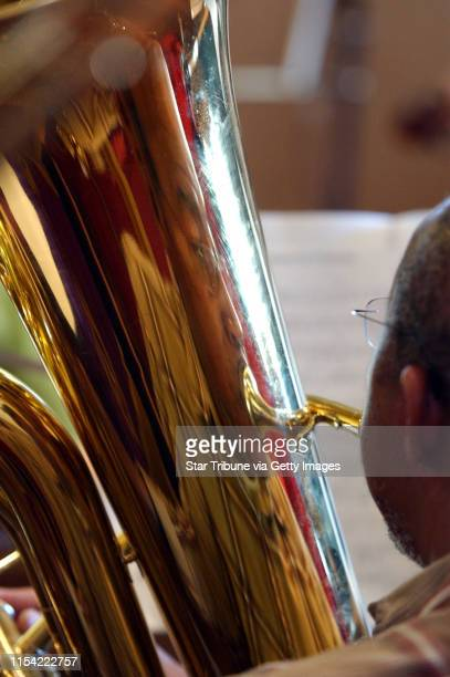 Minneapolis Mn Sat Dec 7 2002Julius Robinson is reflected in the bass tuba he is playing during rehearsal for the St Peter's African Methodist...