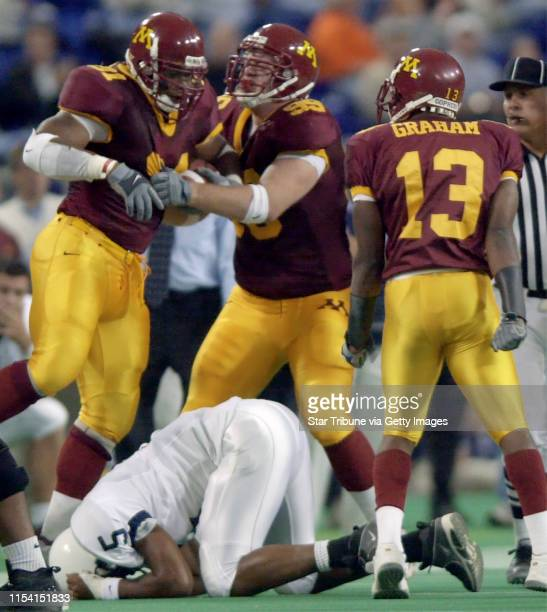 Minneapolis Mn Saturday 10/7/00 Minnesota vs Penn StateA dejected Larry Johnson of Penn State lies face down after fumbling the football as Minnesota...