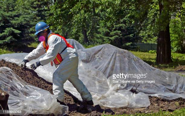 Minneapolis, MN., Tuesday, 6/21/2005. EPA contractors covered exposed contaminated top soil with plastic at the Gluek Park in NE Minneapolis. Twenty...