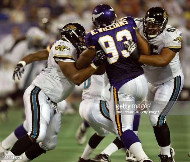 8/9/03 Minneapolis MN Vikings vs Jacksonville at the Metrodome in the season's first preseason game THIS PHOTO Viking number one draft pick defensive...