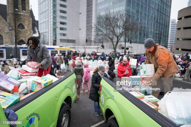 Volunteer Robert Hill of Minneapolis left helped load donations onto trucks as residents were bussed to temporary shelters Hundreds of people donated...