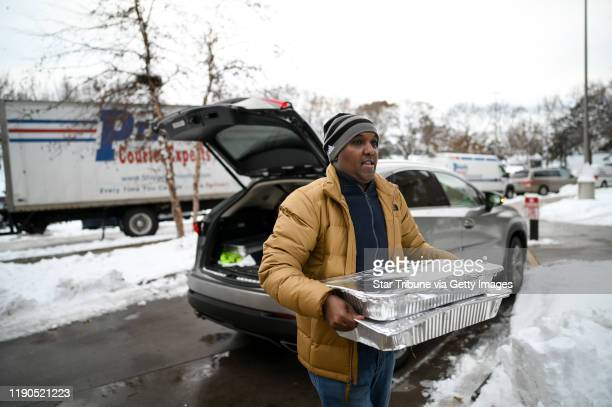 Minneapolis, MN-November 27: Abdirahman Kahin, owner of Afro Deli, donated food to residents of the Cedar Riverside tower where five people were...