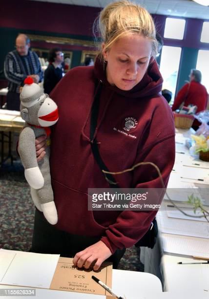Minneapolis MnSatApril 3 2004Jenny Lenz of Minneapolis picked up a sock monkey at the Early Bird Extravaganza a fund raising event for the Steven...