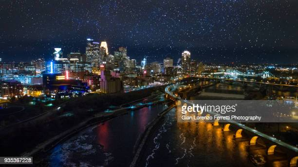 minneapolis night skyline - downtown & stone arch bridge - minneapolis stock photos and pictures