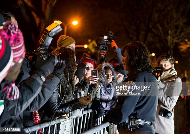Minneapolis Police Chief Janee Harteau right speaks with Black Lives Matter organizer Mica Grimes separated by a barricade outside the 4th Precinct...
