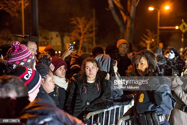 Minneapolis Police Chief Janee Harteau right speaks with protestors separated by a barricade outside the 4th Precinct police station November 20 2015...