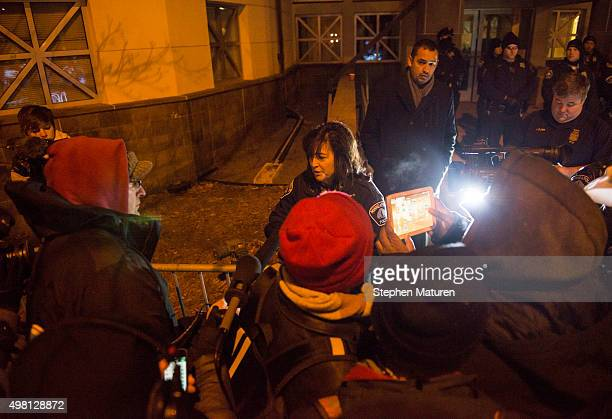 Minneapolis Police Chief Janee Harteau speaks with protesters behind a barricade outside the 4th Precinct police station November 20 2015 in...