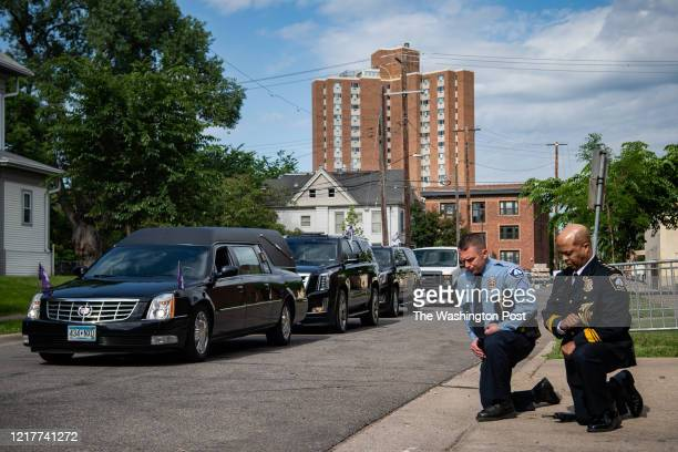 Minneapolis Police Chief Medaria Arradondo, right, kneels as the hearse of George Floyd arrives to North Central University ahead of funeral service...