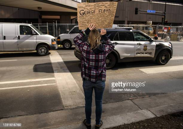 Minneapolis Police cruiser drives by as people demonstrate outside the Hennepin County Government Center on March 9, 2021 in Minneapolis, Minnesota....