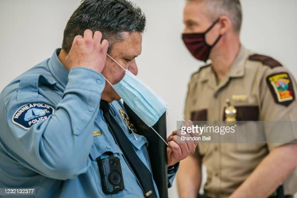 Minneapolis Police Department Assistant Chief Henry Halvorson adjusts his face mask after speaking at a media briefing on April 5, 2021 in...