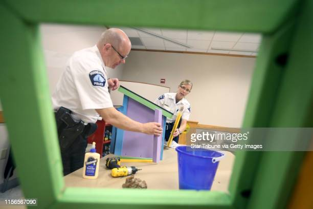 Minneapolis police inspectors Kathy Waite and Mike Sullivan assembled a little free library at City Hall Tuesday May 26 2015 in Minneapolis MN] The...