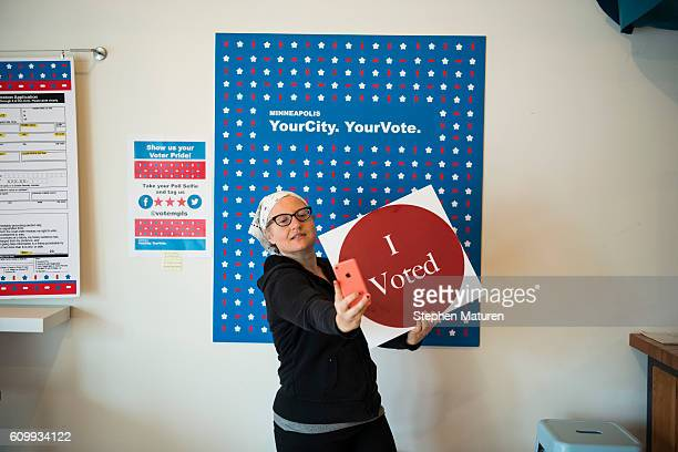 Minneapolis resident Robin Marty takes a selfie with an I Voted sign after voting early at the Northeast Early Voting Center on September 23 2016 in...