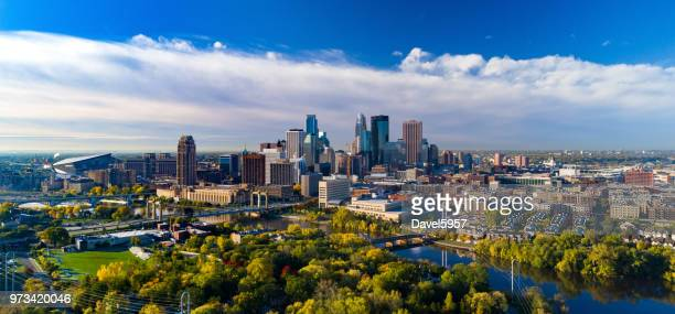 minneapolis skyline aerial with river and golden trees during autumn - minnesota foto e immagini stock
