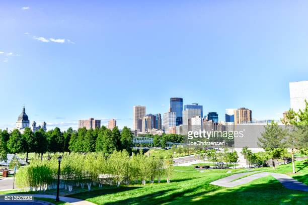 minneapolis skyline and basilica from hill - minneapolis stock photos and pictures