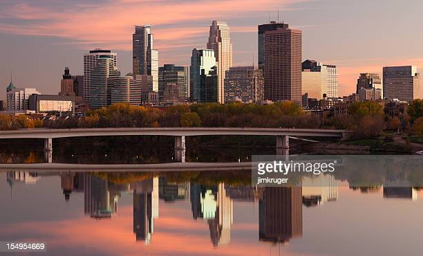 Minneapolis skyline and reflection on Mississippi river.